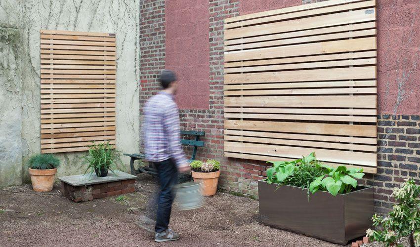Attaching plants to the wood slat wall slat wall