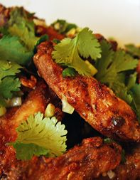 These japanese chicken wings are coated with rice flour, deep fried, and then tossed in a sweet-sour-spicy sauce of honey, lime juice, and pepper flakes. They'll make you crave a cold beverage and wish you'd made more.