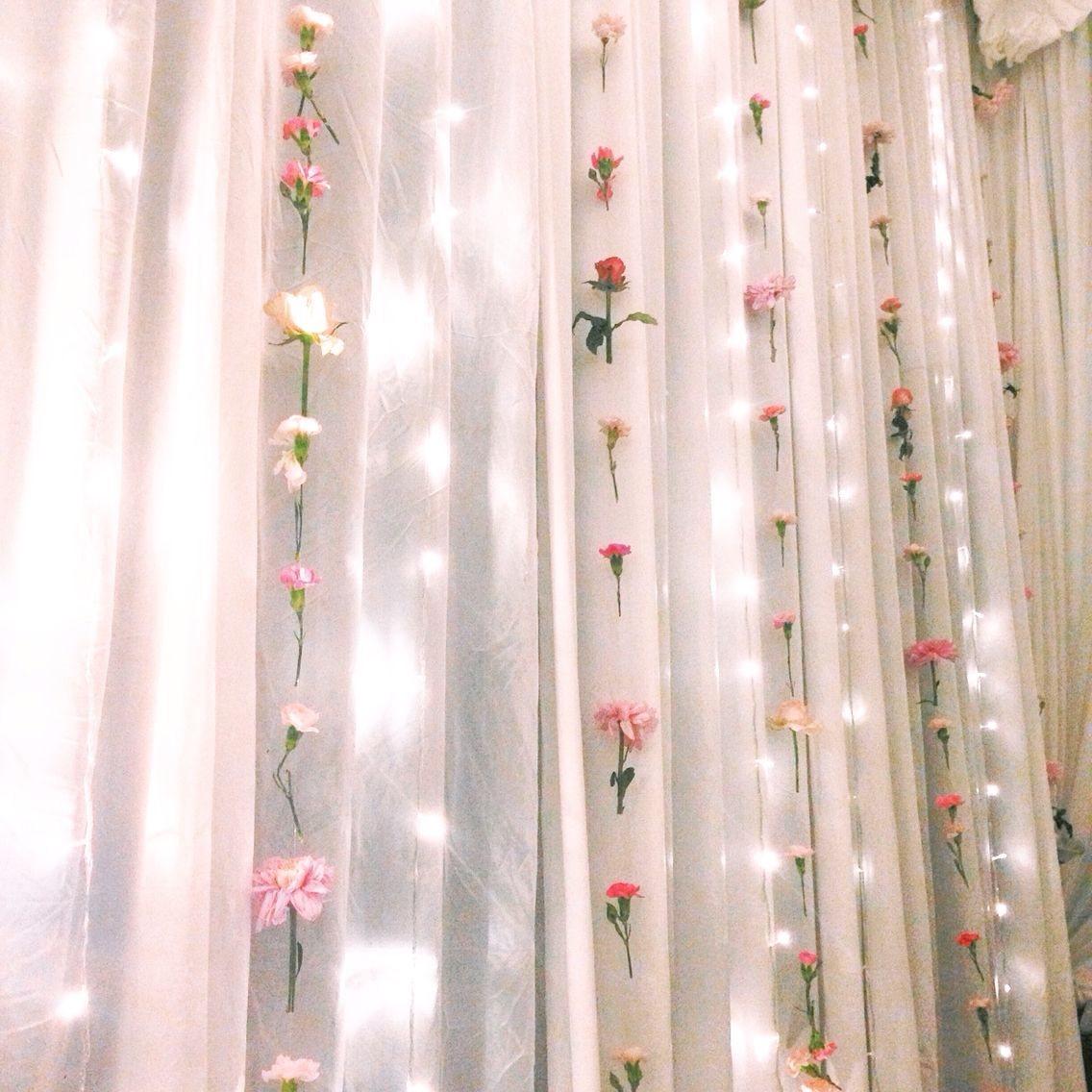 wall of fresh flower and fairy light