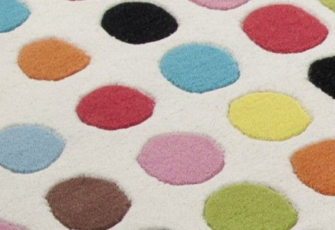 Creating fresh and fun designs for your kids with polka dots.  This rug makes me smile.