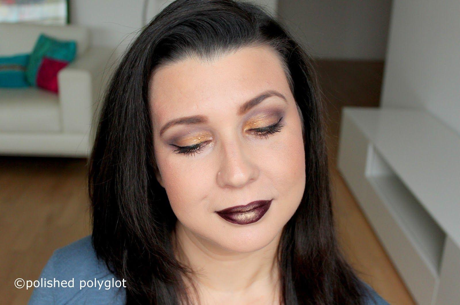 Dark makeup look in tyrian purple and golden glitter, described in ...