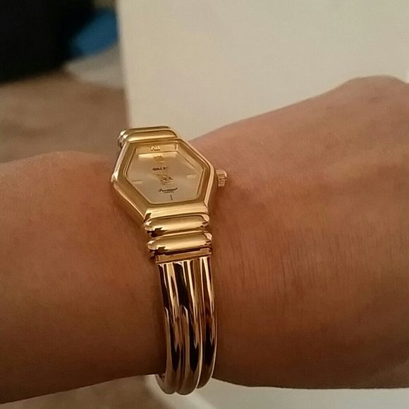 Ladies watch Gold used but not faded, no scratches ladies watch.Bangle type.might fit small to medium wrist Jewelry