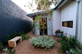 Image result for bright coloured wall courtyard