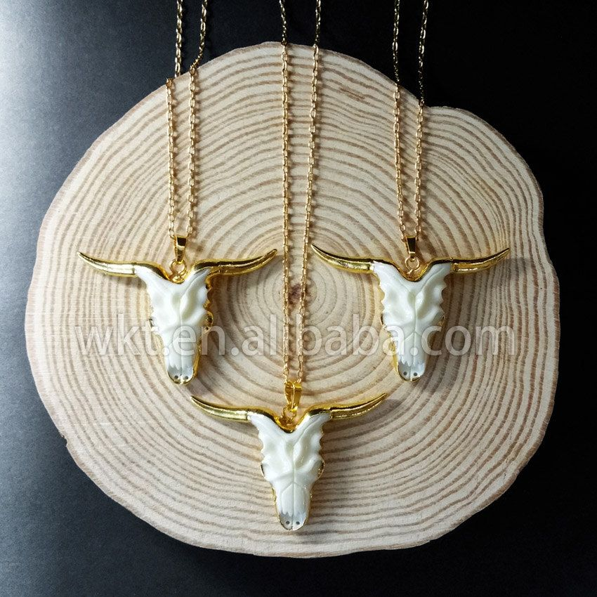 WT-N603 Exclusive natural white resin cattle horn , amazing cattle head horn gold plated necklace by WKTjewelry on Etsy