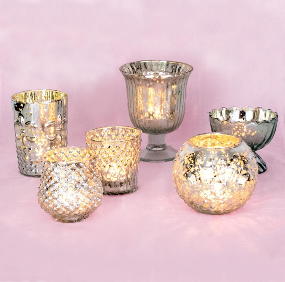 Mostly CLEAR GLASS VOTIVES with white candles. Silver mercury ...