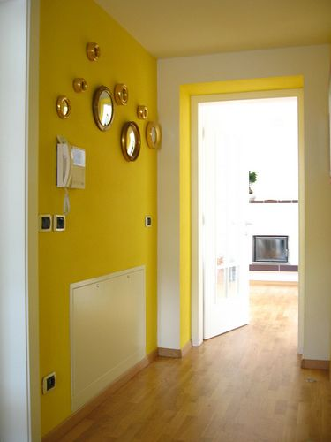 yellow hallway with sorcier mirrors my dream house pinterest