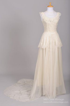 Designed in the 40's, this very unique vintage wedding gown is done in a soft white eyelet organdy. The sleeveless bodice features a sheer chiffon modesty panel with a jeweled neckline, over a ruffled