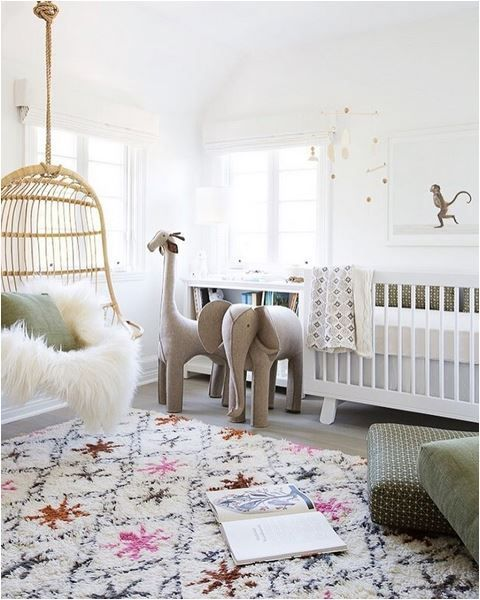 Bohemian Nursery Design Featuring A Pink, Gold, And Gray