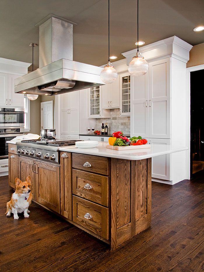 Fabulous gourmet kitchen features a ceiling mount vent hood ...