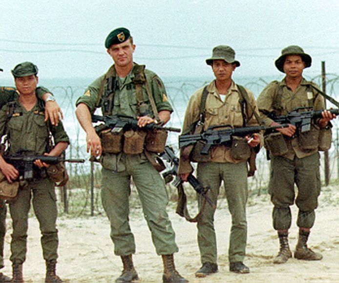 235b5bbab21 U.S. Green Beret flanked by ARVN soldiers