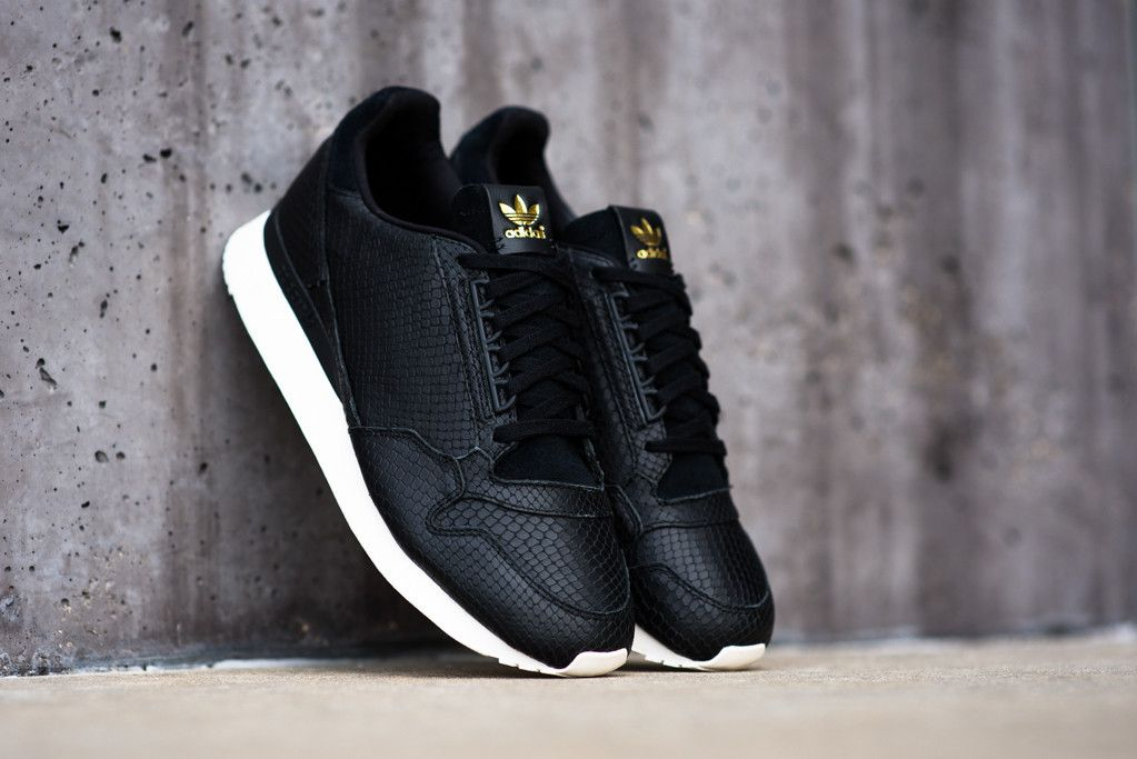 adidas Originals outfits the classic ZX 500 runner in a luxurious and sleek  'Black Snake' look.