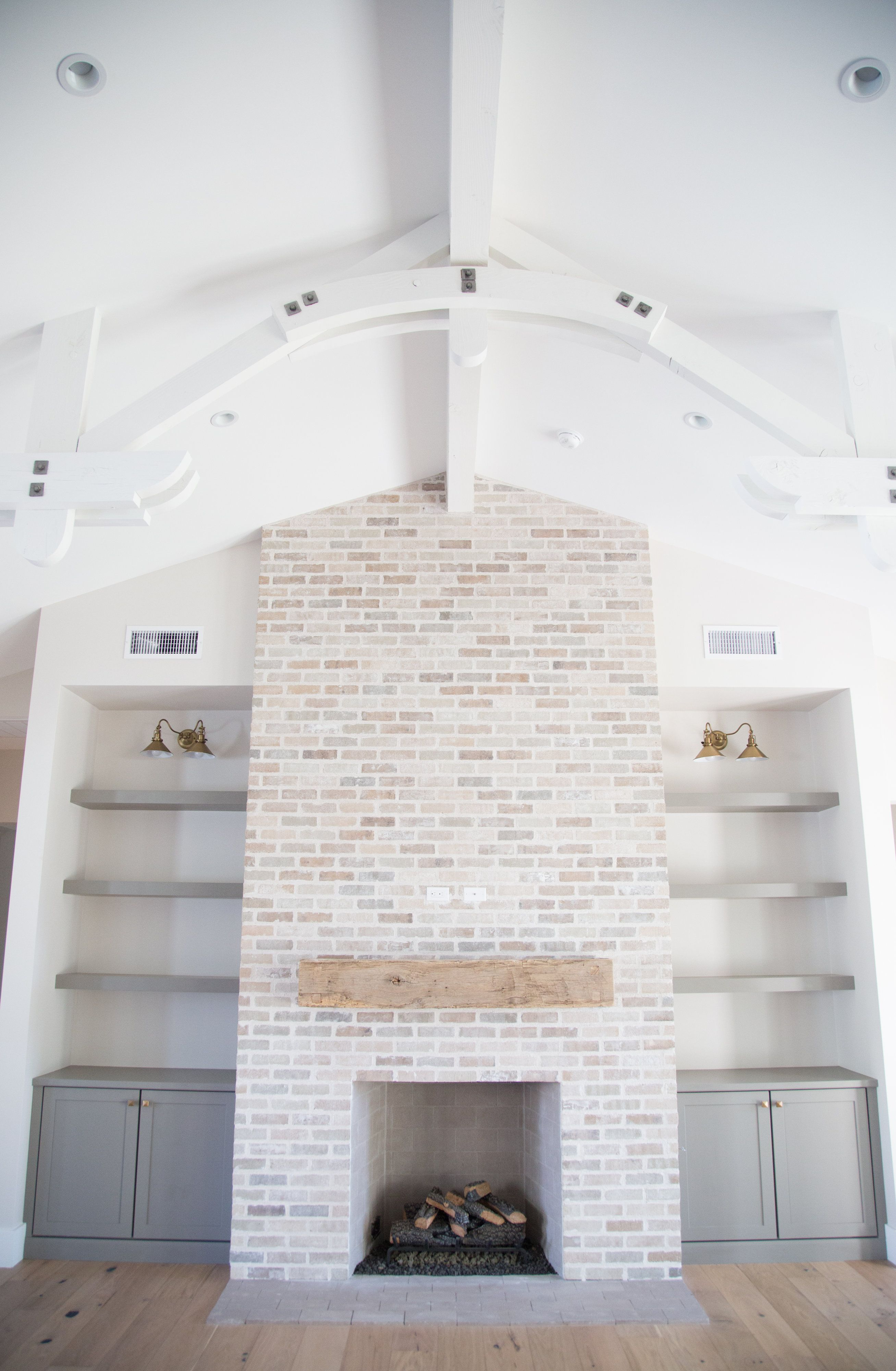 Tumbled Brick Fireplace With Grey Bookshelves And Arched Beams By Rafterhouse Brick Fireplace Makeover Farm House Living Room Home Fireplace