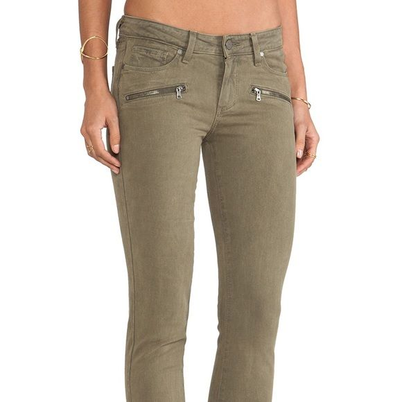 Paige Jeans Paige denim jeans in the Indio Zip style. It features four front pockets (2) with zippers and silver hardware. Made with 98% cotton and 2% elastane. One small stain that will come out once washed! Color is a nice dark army green.                         ✅ Offers welcome (use offer button)  ✅ Bundle 2 or more items for 15% off   Free gift with purchases of $20+  ❌ No trades  ❌ No PayPal ❌ No holds Paige Jeans Jeans Skinny