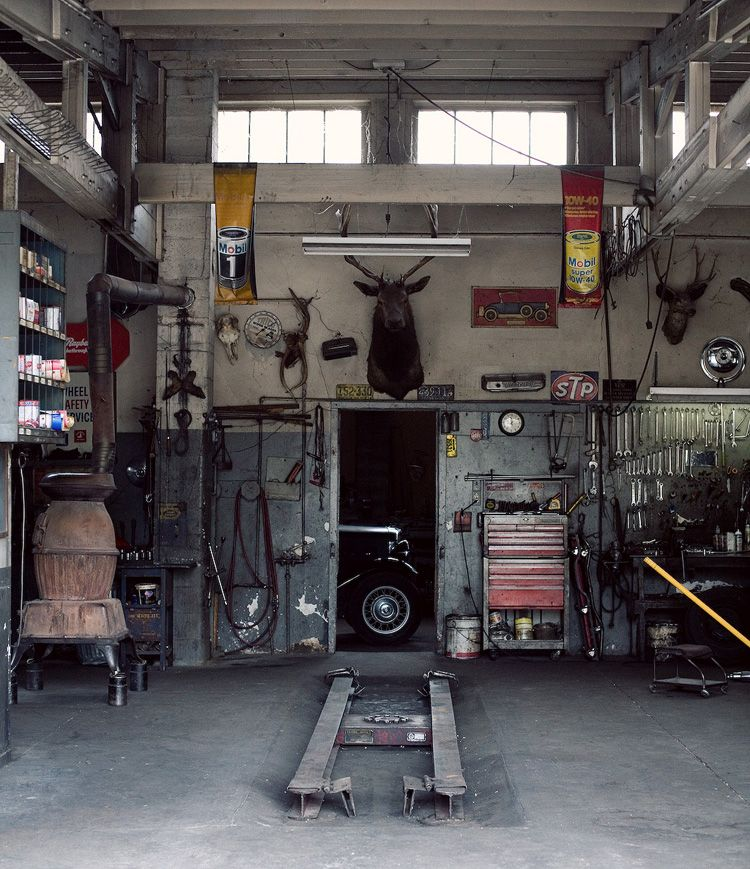 Country And Cool A Garage With Potbelly Stove Hunting Trophys On The Wall