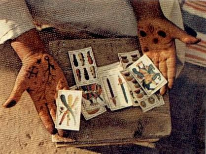"""National Geographic June 1971:  """"Intent on his future, a man in Jemaa el Fna square, the Marrakech marketplace, hears a prediction from a card-reading fortuneteller. Another seer paints her palms with henna."""""""
