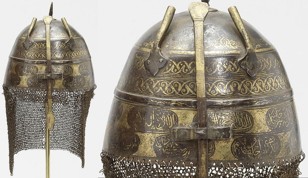 Indian (Mughal), 18th century  khula-khud (helmet) of domed form surmounted by spike with an elongated nose guard, traces of gold koftgari decorations consisting of floral intertwined vine shapes and inscriptions, two plume holders, mail neck guard attached to the rim.