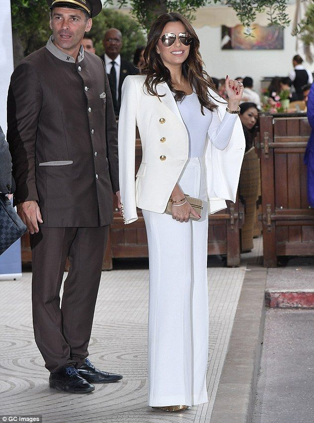 9cc0b2d9bd6 Minimal look  Eva Longoria in a classy double-breasted cream blazer and  wide legged trousers on May 13