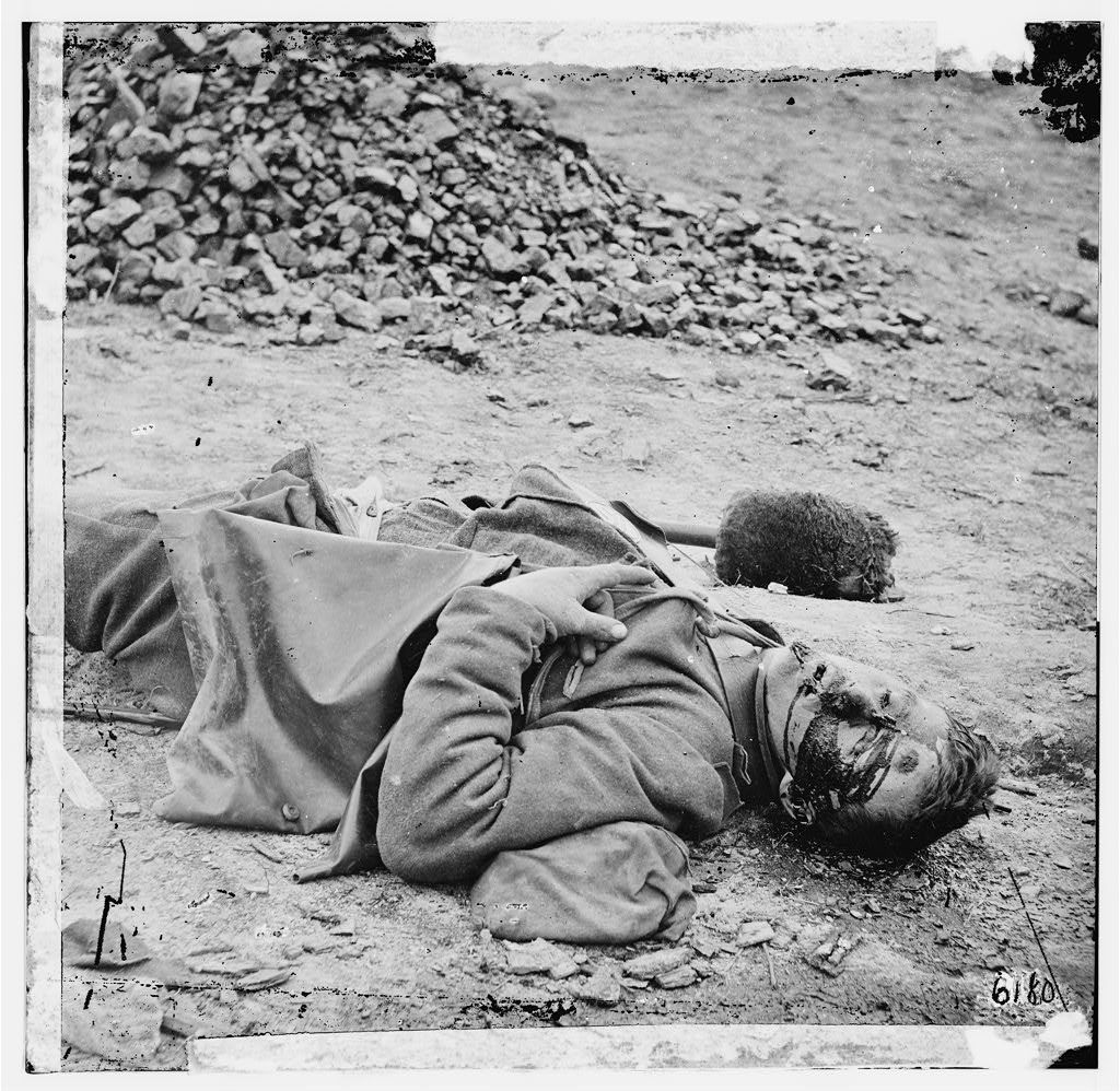 Dead Confederate soldier in trenches at Petersburg, Virginia.