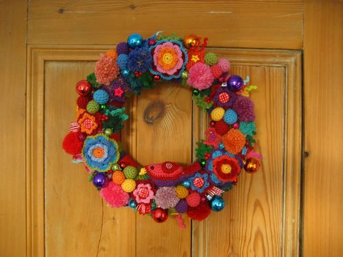 Crochet Christmas Wreath, I love the idea of doing one of these though I think I'd stick with more seasonal colours for my own (her's is great though!)