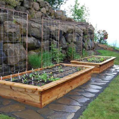 These are really beautiful raised beds i love the stone for Beautiful raised gardens