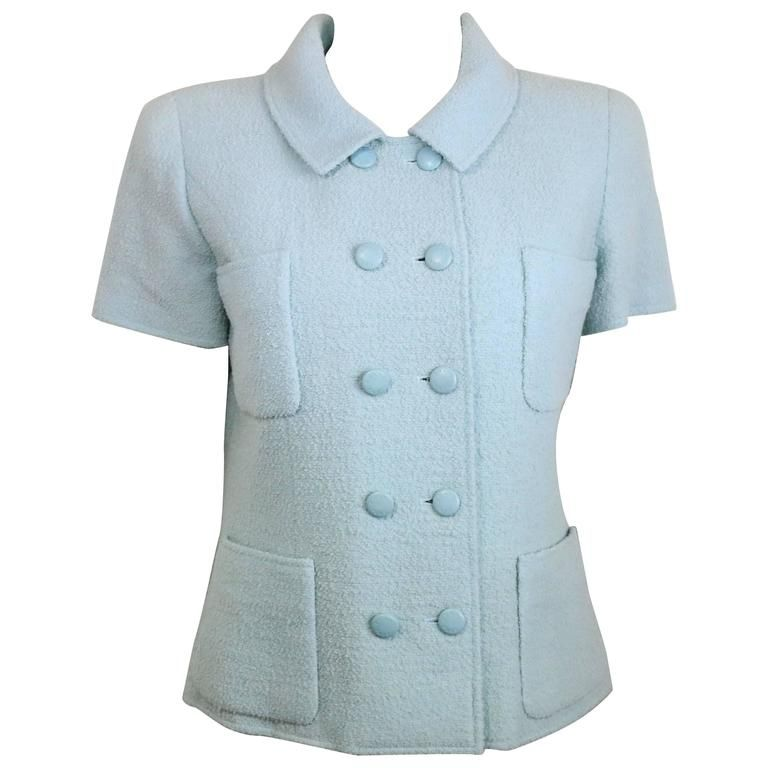 - Vintage Chanel baby blue boucle wool double breasted short sleeves jacket from 1996 collection cruise. - Made in France. - Size 40. - 95% Wool, 5% Nylon. - Include: Orignal Hanger. Orignal tag still attached to it.
