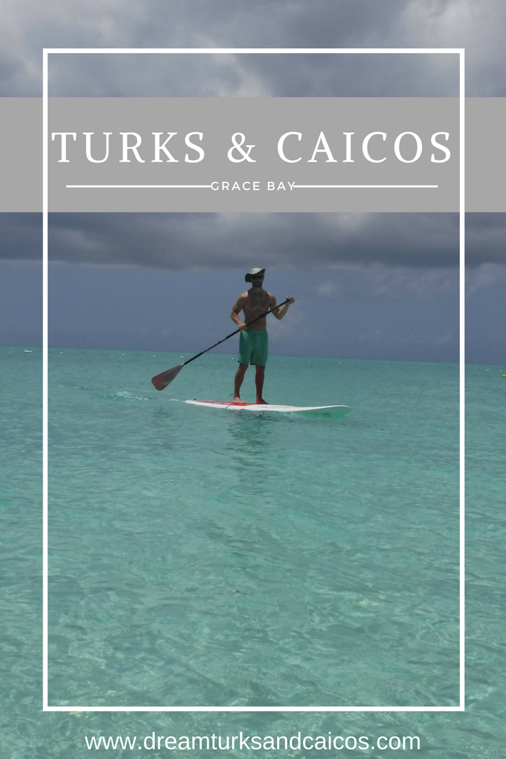 Paddleboarding in Grace Bay is a great beach activity.
