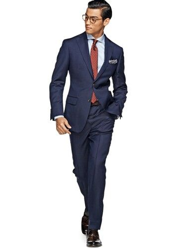 Navy blue suit, silver/gray shirt, red tie