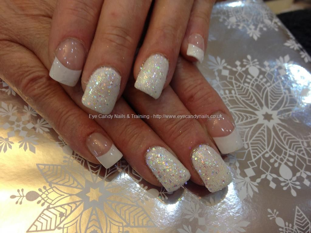 acrylic nails with white tips and two white glitter fingers