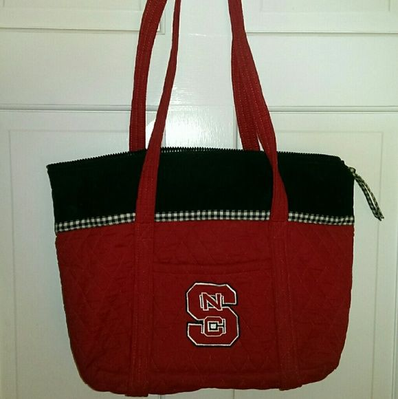 NC State quilted purse/bag NC State quilted bag.  Zips across top.  Small pocket on front, and 6 pockets inside.  Used, but good condition.  Measures approx 12 x 16 x 4 inches.  Straps extend about 11 inches above bag. Bags Shoulder Bags