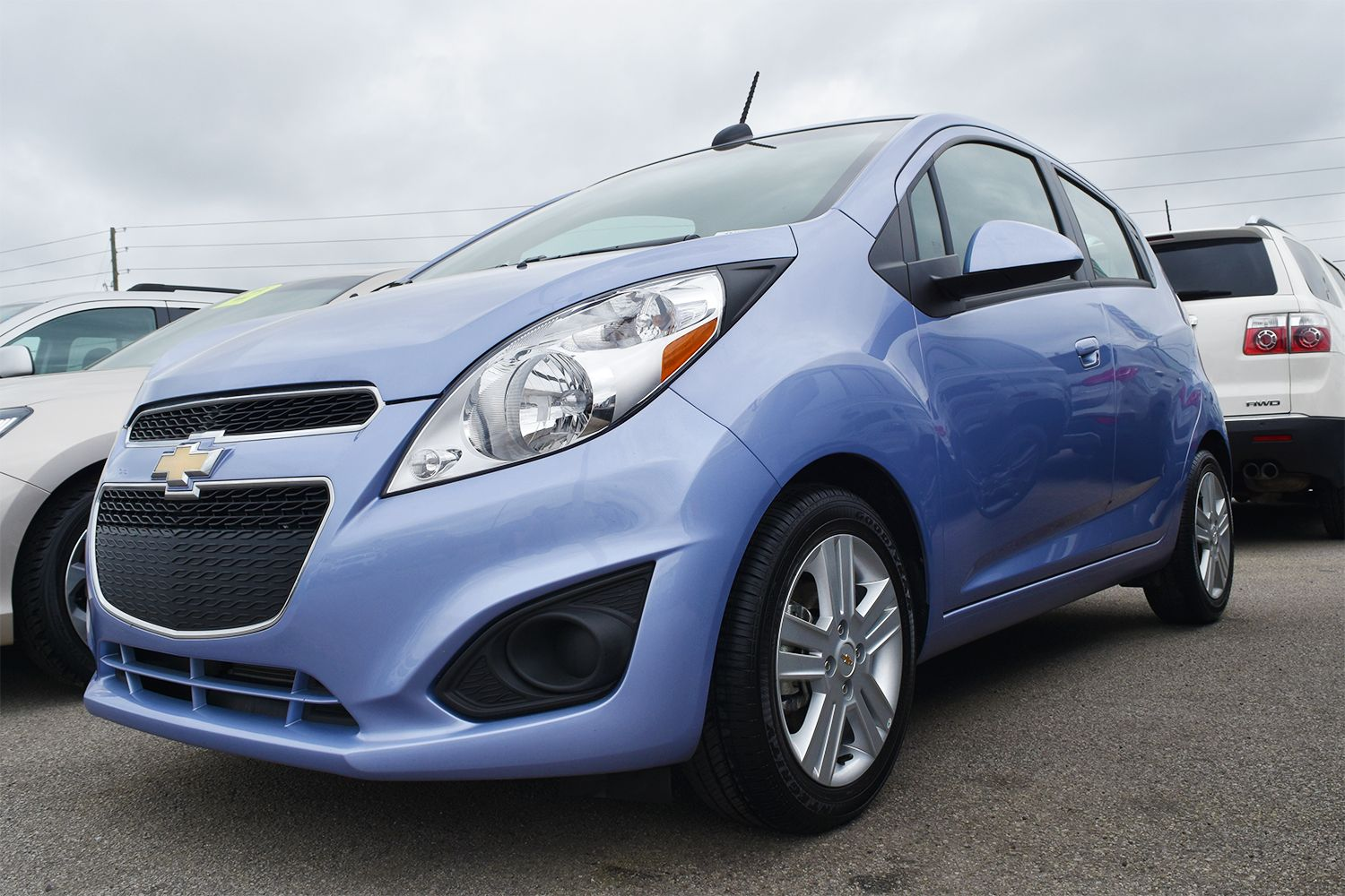 We Have Plenty Of Pre Owned Vehicles Perfect For The Spring Including This 2015 Chevy Spark That Resembles An Easter Egg Chevy Bmw Car Vehicles