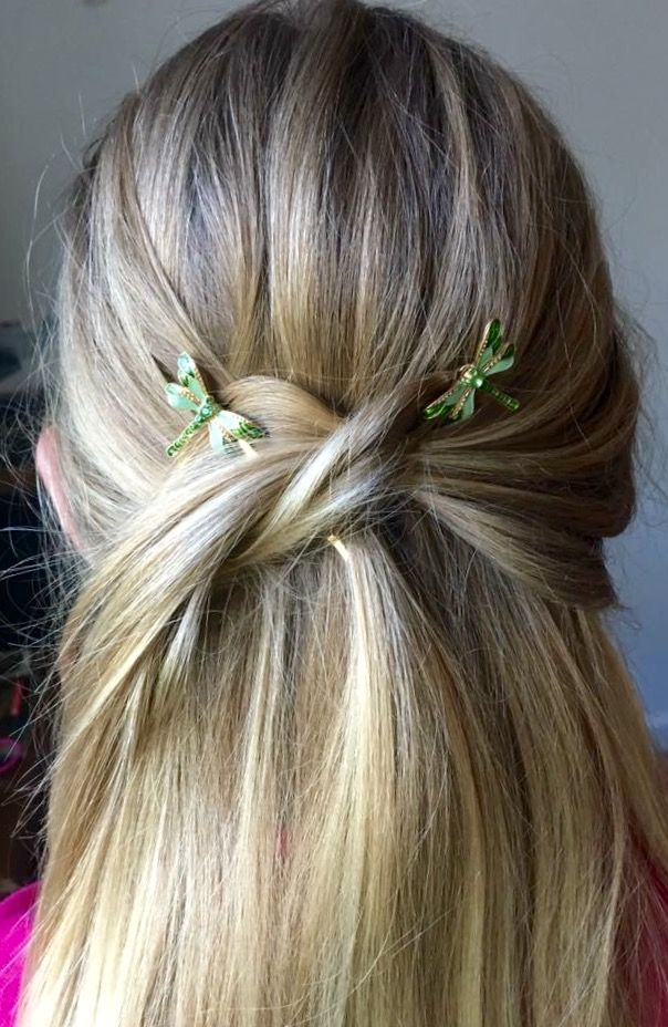 Pretty knotted half up hair style pinned with gorgeous glittering green and gold dragonfly bobbies