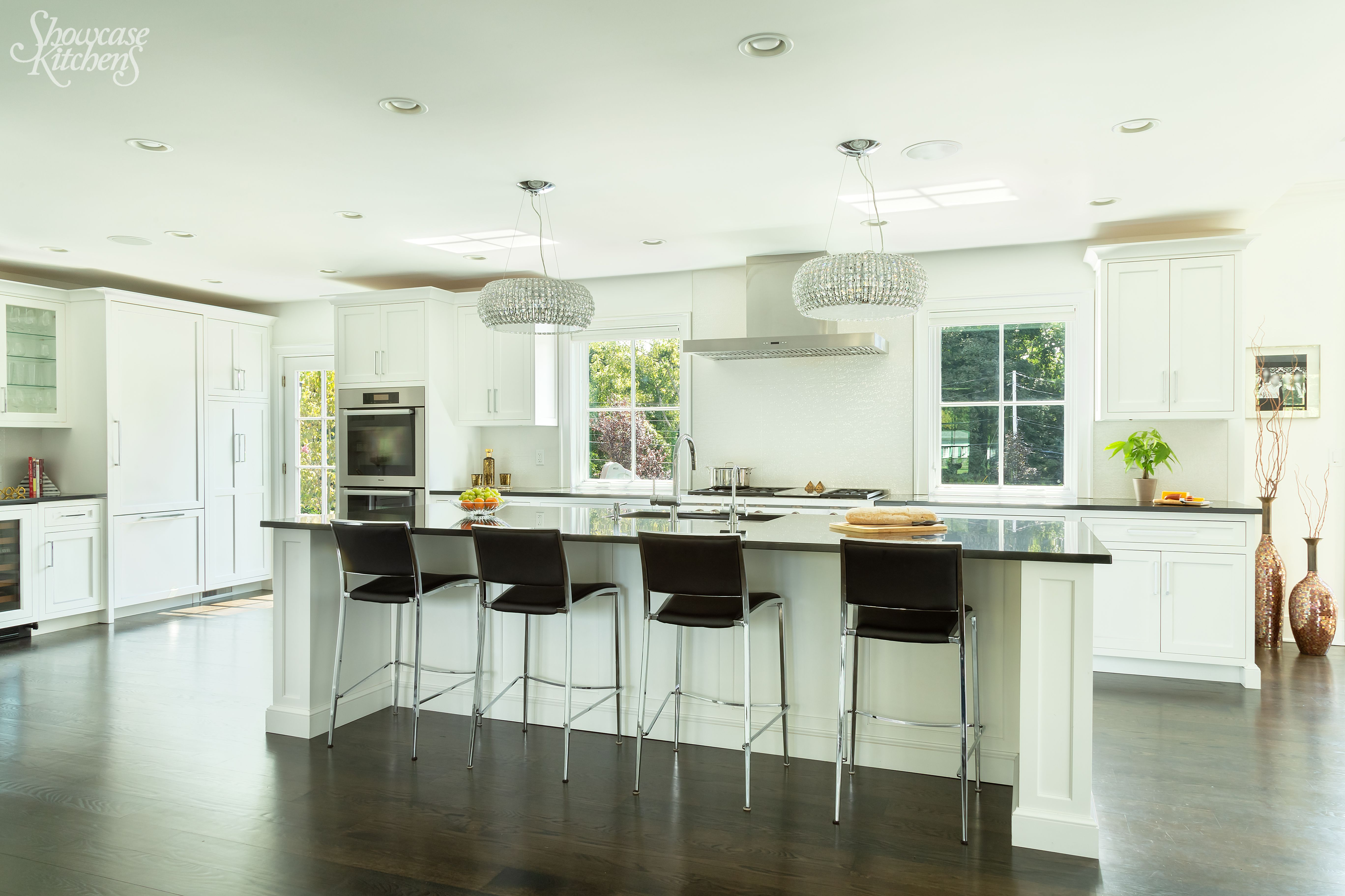 black granite countertops and stools add a pop of black in this transitional white kitchen on kitchen decor black countertop id=76974