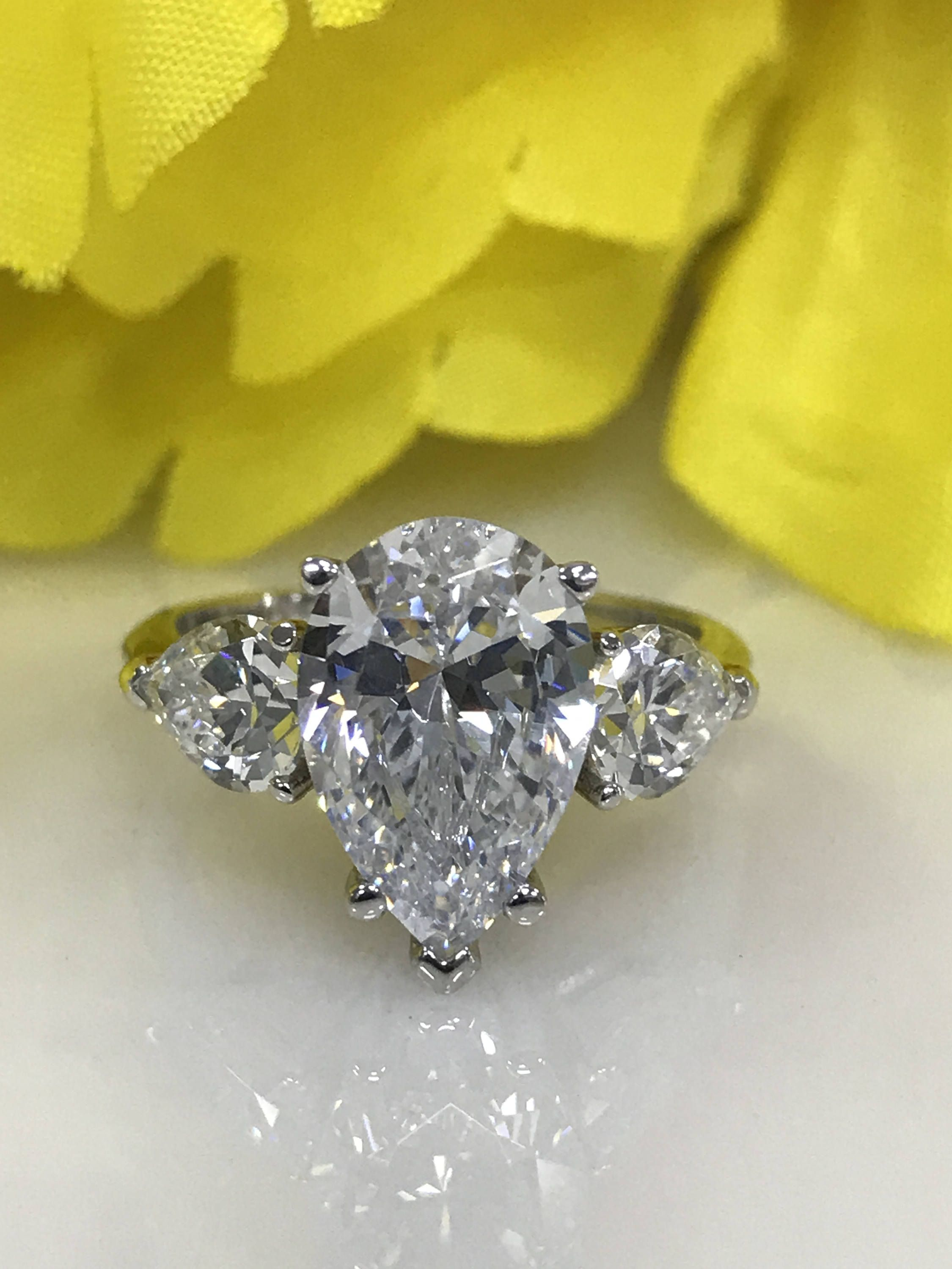 61940a7139b8c Engagement ring with Pear Shape Russian Cut diamond and Pear Accents ...