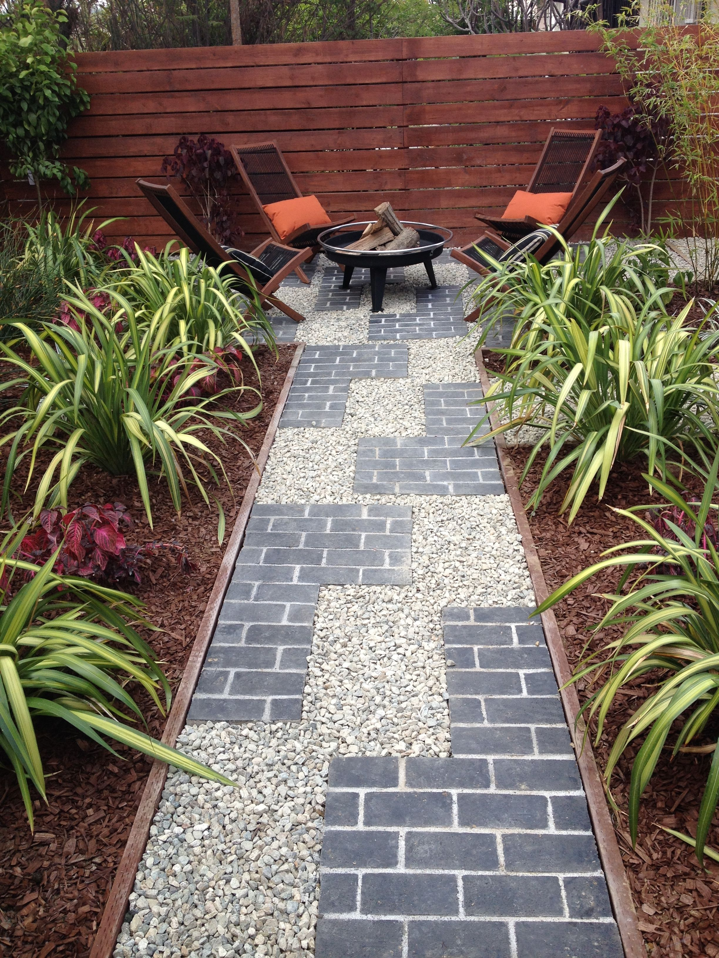 Tetris inspired pathway with grey brick and gravel for Wooden garden edging