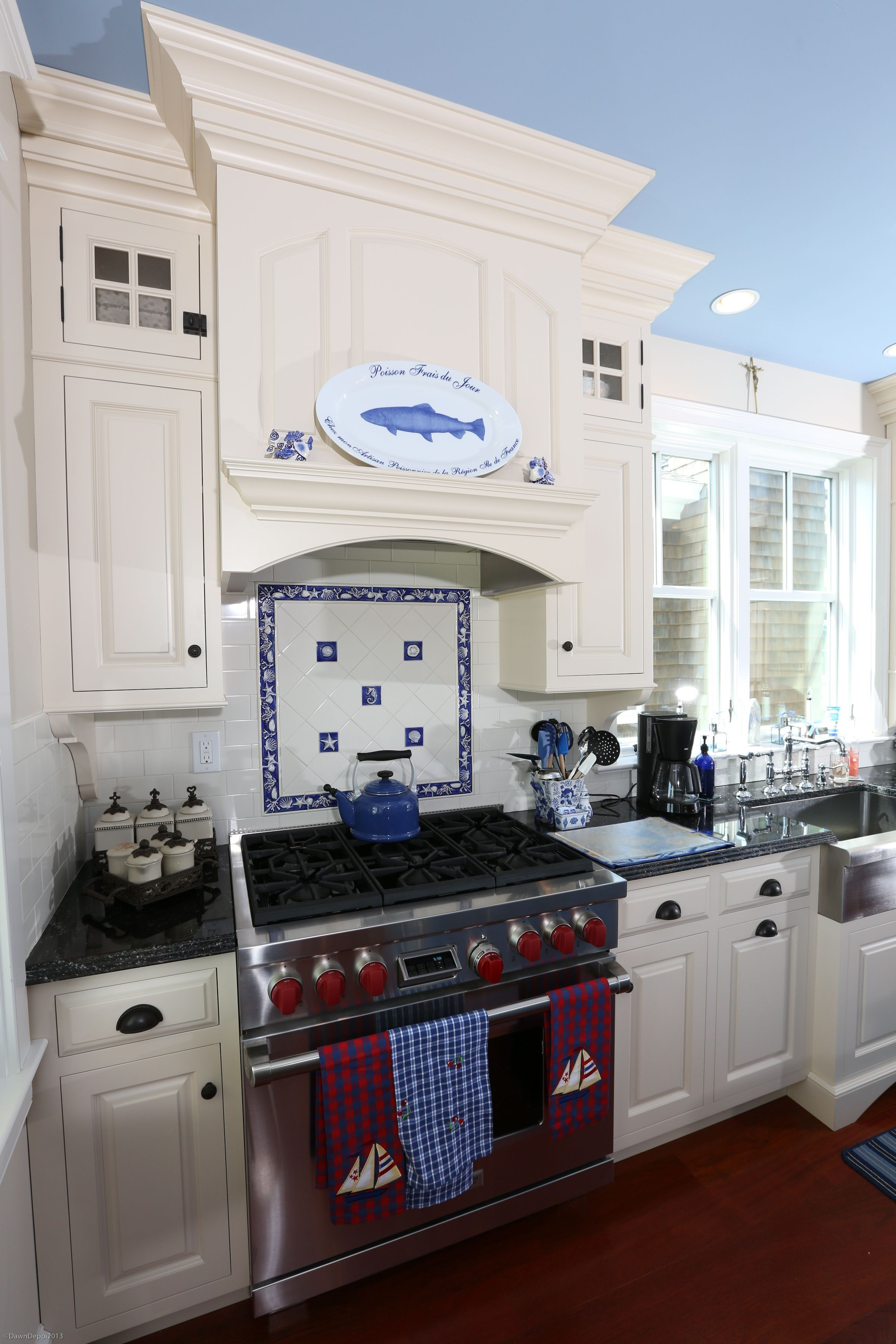 Closeup of custom Wood Hood Detail with arched wainscot panels, and ...
