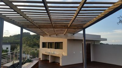 Wood Concrete And Steel Furniture Combined With Decking Pergolas