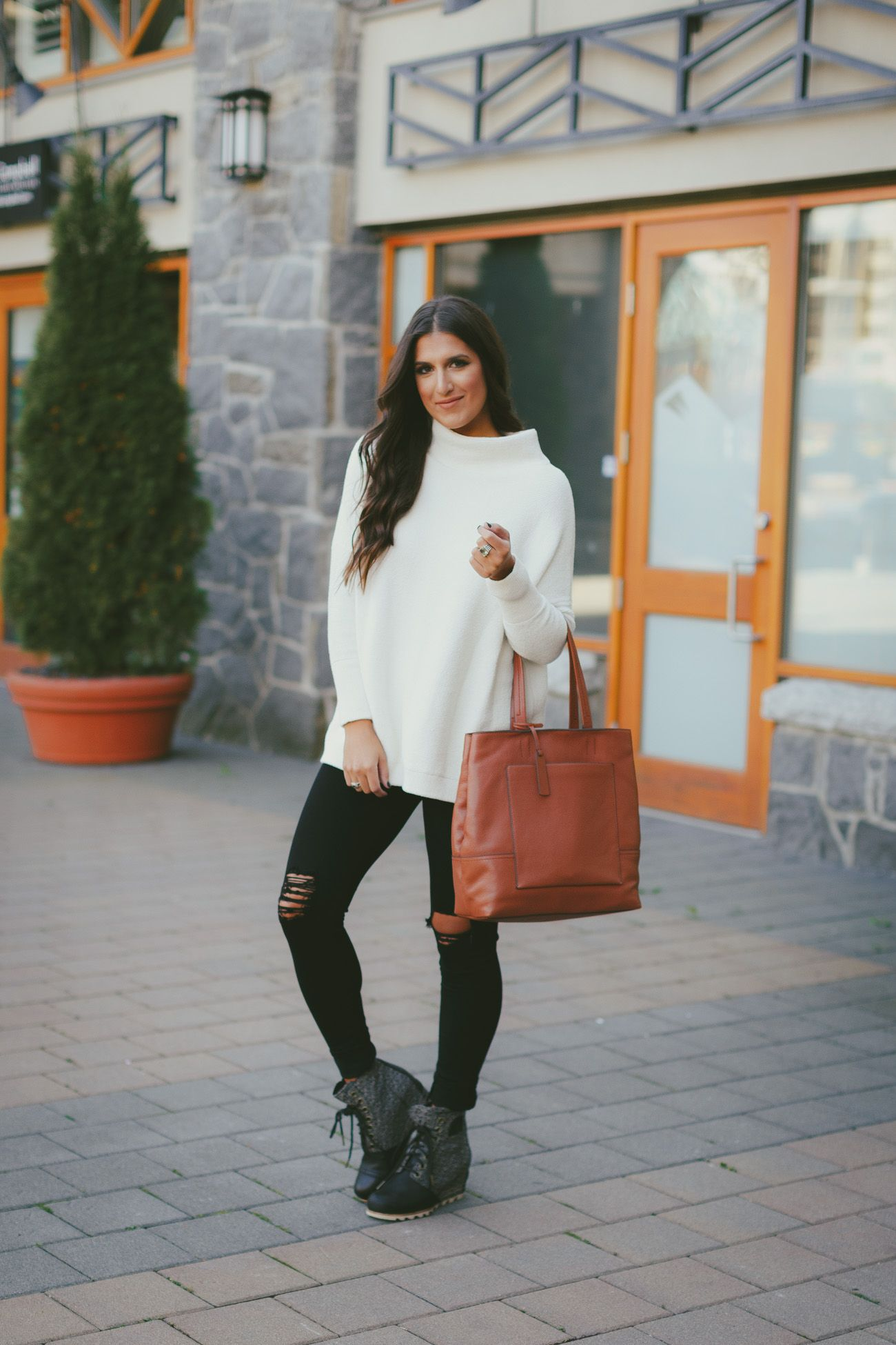 ad88d050551e Cozy Mountain Style | A Southern Drawl. White sweater+black ripped  jeans+black laced boots+brick red tote bag. Fall Outfit 2016