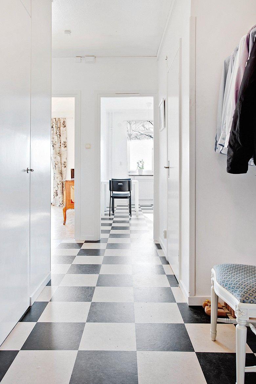 Hallway so simple. I love black and white floor