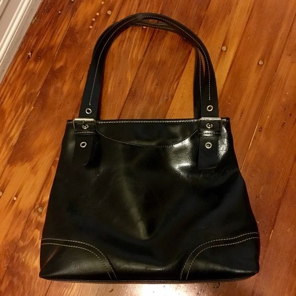 Black vegan leather purse Great condition! Never worn. Comfortable shoulder purse. Has 3 sections inside. Middle section is enclosed by a zipper for added security. Many pockets inside and one large pocket on the outside of purse. Purse handle has a belt loop to be adjusted a bit. Bags Shoulder Bags
