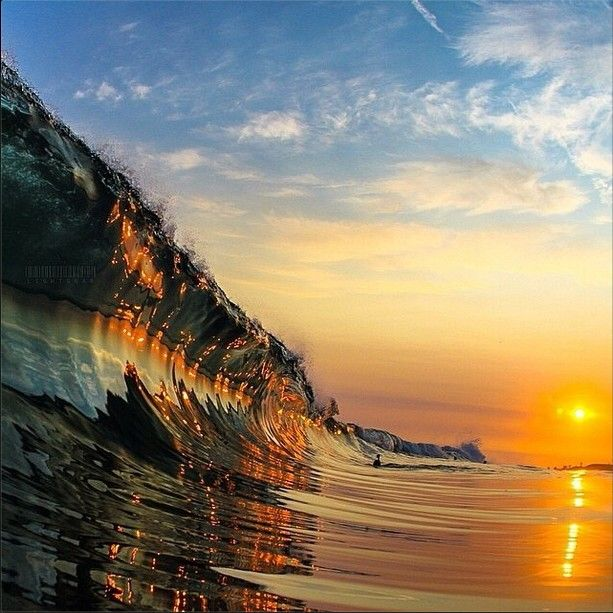 Reflecting sunset of a wave