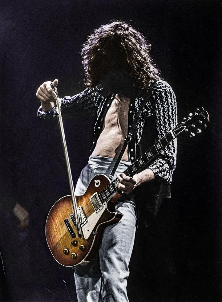 Jimmy Page playing a Les Paul with a cello bow, 19