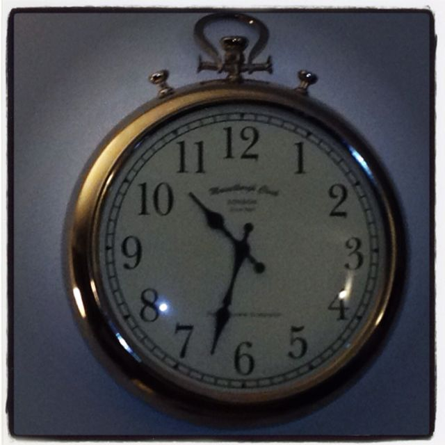 My living room wall clock - I love pocket style watches and clocks.