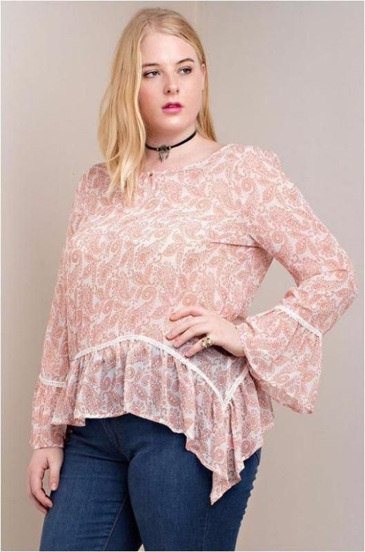 3045a998849 Kori America Sheer printed plus size blouse with ruffle drop asymmetrical  hem and ruffle sleeves. Small trim and covered button keyhole neckline.