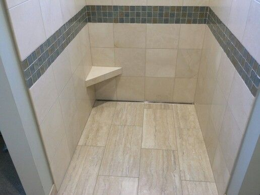 Marble Shower With Linear Drain And Shaving Foot Rest For The Ladies. Tile  Installed By