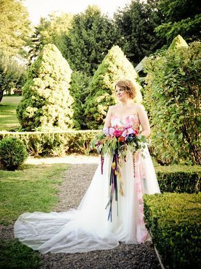 Bride Katie Wadhams wears a custom water-color paneled bouquet created by Stacy K Floral