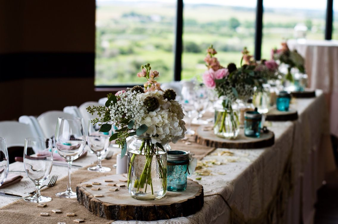 Loved our centre pieces.. a little touch of color, mason jars, and beautiful birch wood.