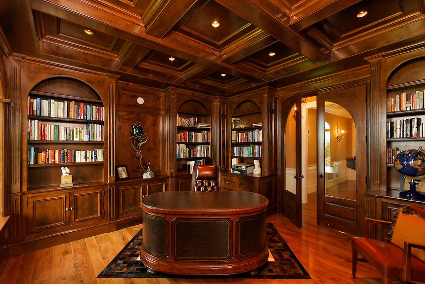 Traditional Home Office Library With Dark Paneling And