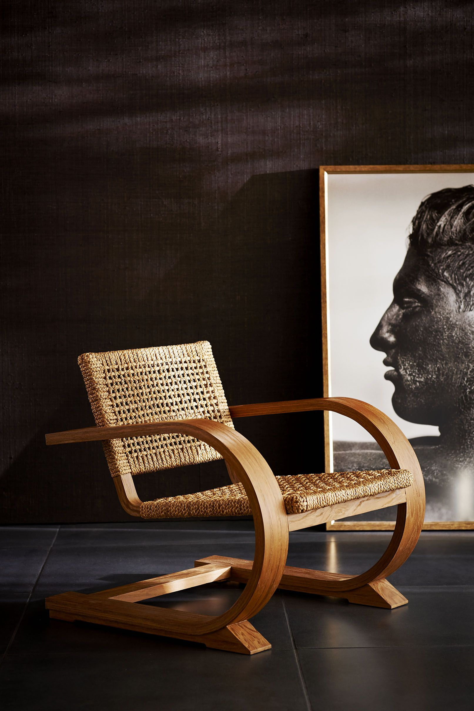 The beautifully crafted Black Palms Arm Chair, in warm teak and ...