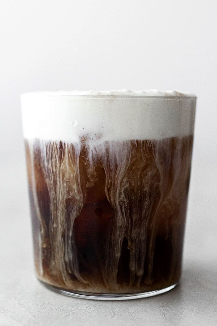 Decadent iced coffee with cream froth coffee at three in