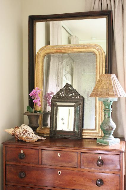 for the love of a house: love how Joan layered the three mirrors